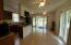 Spacious kitchen /den opens to porch
