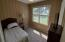 3rd bedroom with painted paneling could be nice office