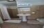 Tile bath with shower adjoins one bedroom