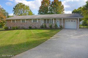 Brick, level yard, large driveway.