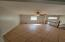 Upstairs living room. Tile floors throughout