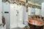 Guest Bathroom Features Copper Pedestal Sink and Tile Floors