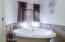 Relax in the Jacuzzi Tub in Master Bathroom