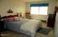 48988 US 101 S, 330, Neskowin, OR 97149 - queen bed in large bedroom