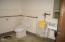 178 NE Metcalf Ave, Siletz, OR 97380 - Mens restroom