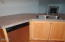 475 SE 35th St, A1, Newport, OR 97366-9824 - Kitchen With Fireplace in Living