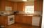 296 Bella Beach Drive, Depoe Bay, OR 97341 - Sunny kitchen w/gas range