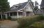 296 Bella Beach Drive, Depoe Bay, OR 97341 - Hosue with detached garage behidn