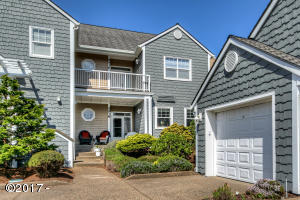 5938 SW Cupola Dr, South Beach, OR 97366-9624 - Front of Condo