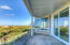 5938 SW Cupola Dr, South Beach, OR 97366-9624 - back porch