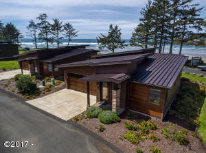 "Contemporary ""like new"" single level oceanfront home."