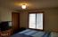 1918 NE Spindrift Ct, Lincoln City, OR 97367 - bedroom with walk-in closet