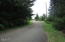 320 SE Evergreen Dr, Waldport, OR 97394 - Street looking South