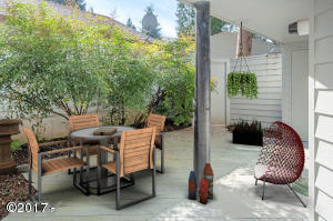 Private courtyard. Displayed virtually staged