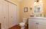 319 Kinnikinnick Way, Depoe Bay, OR 97341 - Half Bath and Laundry Door