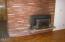 245 NE Edgecliff Drive, Waldport, OR 97394 - Living room side fireplace