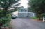 9 E Devils Lake Rd, Otis, OR 97368 - House to the North of lot