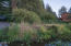 9 E Devils Lake Rd, Otis, OR 97368 - Canal frontage