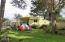 2523 NW Oar Ave, Lincoln City, OR 97367 - Rear view of home with greenhouse