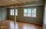 2523 NW Oar Ave, Lincoln City, OR 97367 - Living room features wood framed windows