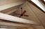 Vaulted ceiling with great beams and fan