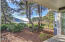 6335 SW Arbor Dr, South Beach, OR 97366 - back porch/deck
