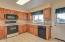 6215 NE Oar Dr, Lincoln City, OR 97367 - Kitchen with access to deck