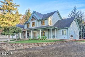 543 N Bayview Ct, Waldport, OR 97498 - Front Of The Home With Covered Porch