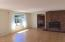 3043 NE 32nd Dr, Lincoln City, OR 97367 - Living room with fireplace