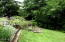 126 N Echo Dr, Otis, OR 97368 - front yard in bloom