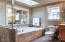Handheld shower, framed & mirrored wall w/shelf.