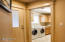 Built in cabinets, sink and washer & dryer