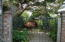 939 NW Highland Dr, Waldport, OR 97394 - gated path to entry patio