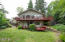 2137 NE Lake Dr, Lincoln City, OR 97367-4226 - West view of home