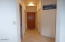 9390 SW Brant St, South Beach, OR 97365 - Entry hall to garage