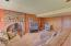 1276 NE Lakewood, Lincoln City, OR 97367 - Brick fireplace with wood stove