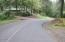 103 Salishan Dr, Gleneden Beach, OR 97388 - Tree lined street