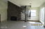 5521 NW Jetty Ave, Lincoln City, OR 97367 - Gas fireplace and stairs to loft