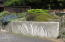 515 NW Terrace St, Waldport, OR 97394 - Custom Art on Retaining Wall