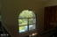 214 NE Camp One Rd, Yachats, OR 97498 - Arched window above entryway