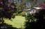 9339 NW Kimberley Way, Seal Rock, OR 97376 - Yard and Shrubs