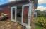 47 SW Hurbert St., Newport, OR 97365 - Garage entrance from yard