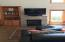 7770 Brooten Mountain Loop, Pacific City, OR 97135 - Living Room Gas Fireplace & Built-in cab