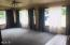312 N Vista Terrace, Otis, OR 97368 - Living Room with drapes