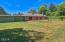 9679 SE Cedar St, South Beach, OR 97366 - Back yard and deck