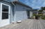 1902 NW Canoe St, Waldport, OR 97394 - Sundeck with door to Sunroom