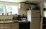 2861 NE West Devils Lake Rd, Lincoln City, OR 97367 - Kitchen with View of the Trees