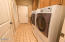160 SW 59th St, South Beach, OR 97366 - Long Laundry area