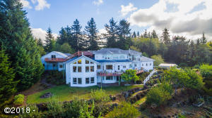 Located atop a hill overlooking the west with southern exposure. Stunning views of the Pacific Ocean, Cascade Head plus forest, mountain & orchard views.