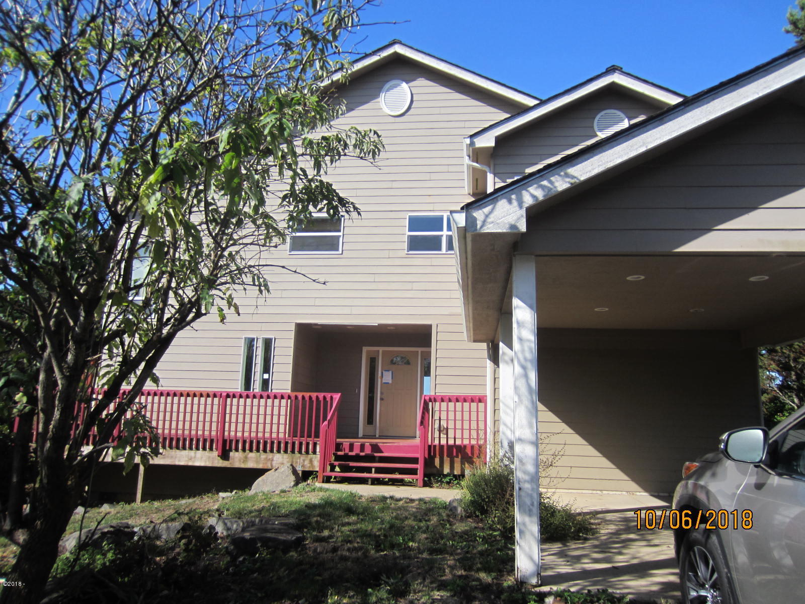 9068 NW Grouse Ct, Seal Rock, OR 97376 - front view